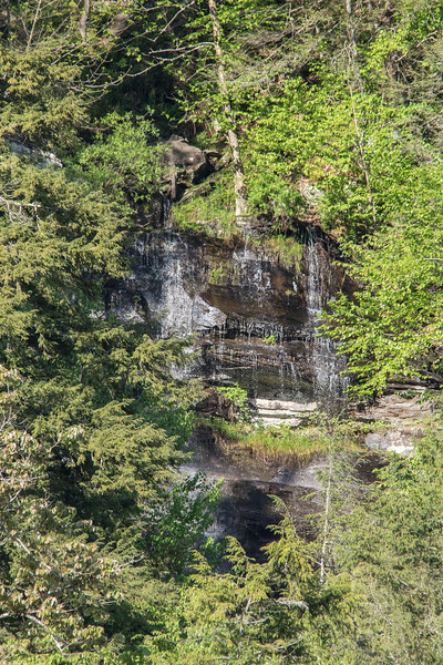 close up of water fall across the river