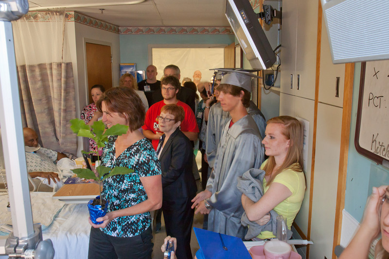 Room packed to overflowing with friends, family, hospital staff and high school staff.