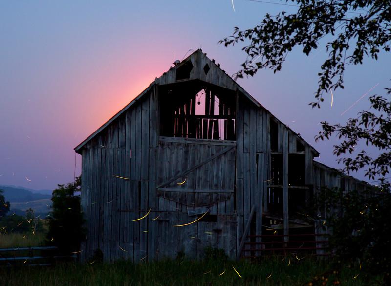 moon behind the old hay barn.
