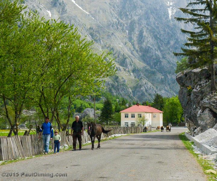 People Walking Along Rruga Azem Hajdari - Valbona, Albania