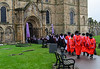 Doctoral Candidates in Red Process into Durham Cathedral @ Durham University Congregation - Durham Cathedral, Durham, England, UK