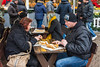Market Goers Enjoying Lángos @ Christmas Market on Vörösmarty tér - Budapest, Hungary