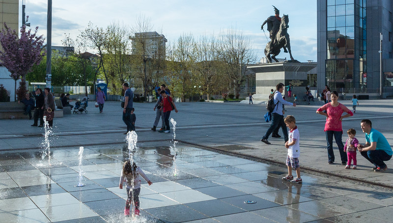 Kids Playing in the Mother Theresa Square fountain - Pristina, Kosovo