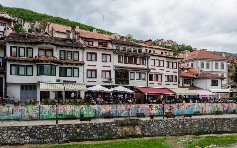 Row of Cafés With Graffiti Along Prizrenska Bistrica River - Prizren, Kosovo