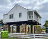 Home being raised on stilts - Ocracoke, NC, USA