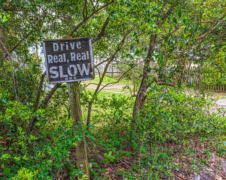 Drive Real, Real, Slow Sign on Howard Street - Ocracoke, NC, USA