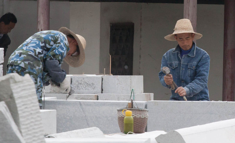 men working on stone for new temple.