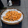 this fruit is called loquat.  Locally called pipa.  I did not try any, but it looked tasty.