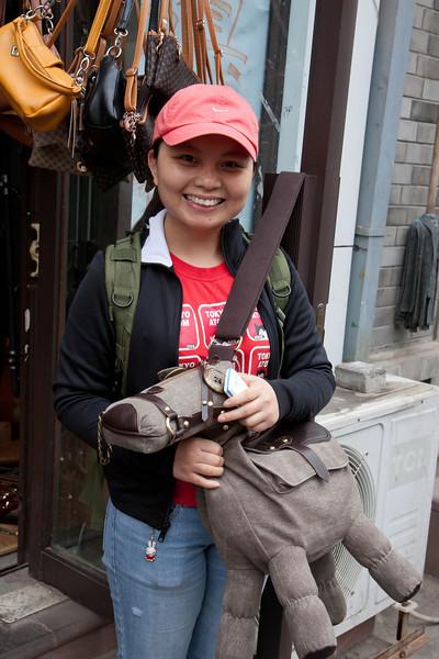 Kay posing with a donkey purse.