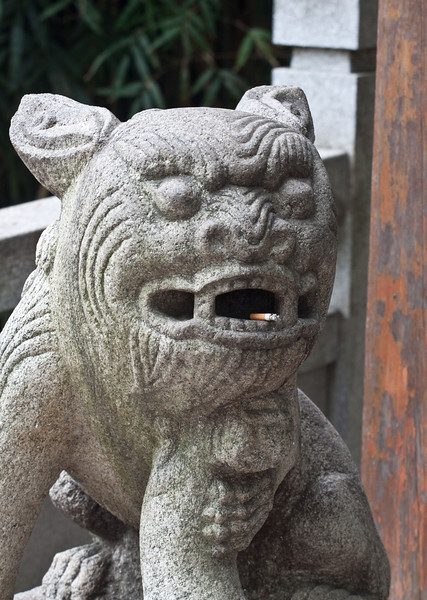 Smoking is very common in China. Even this stone statue was caught smoking.