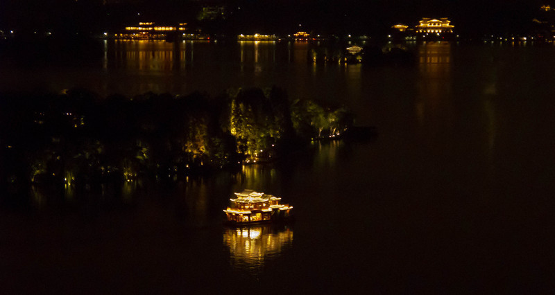 boat by island in West Lake.