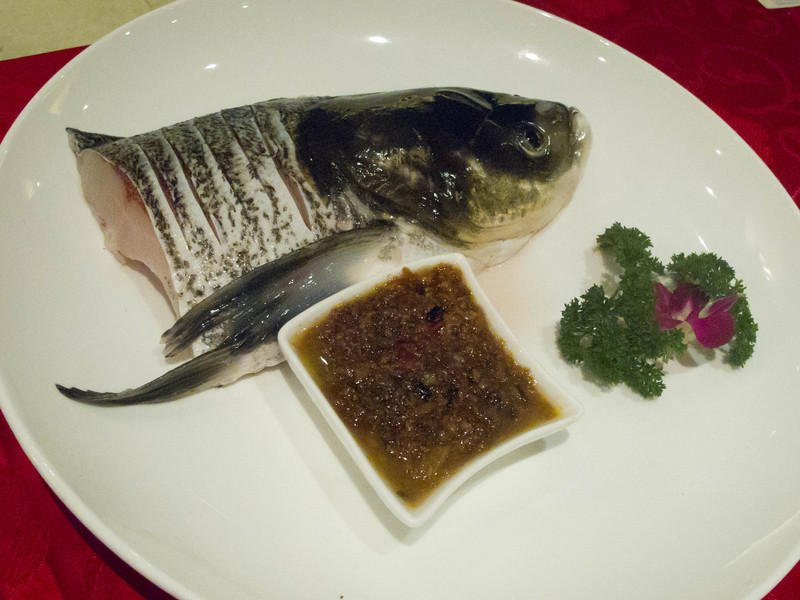 I am not sure what this fish was. It lives in fresh water.  We had one dish with this whole piece in the soup.