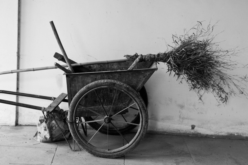 typical street cleaners cart with standard issue bamboo broom.