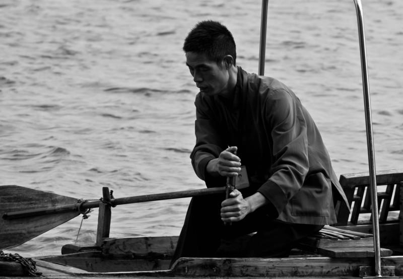 Man rowing boat.