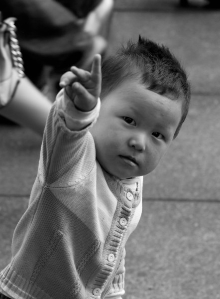 Boy signals with a peace sign.