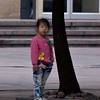 Girl waiting to cross the street in HangZhou.