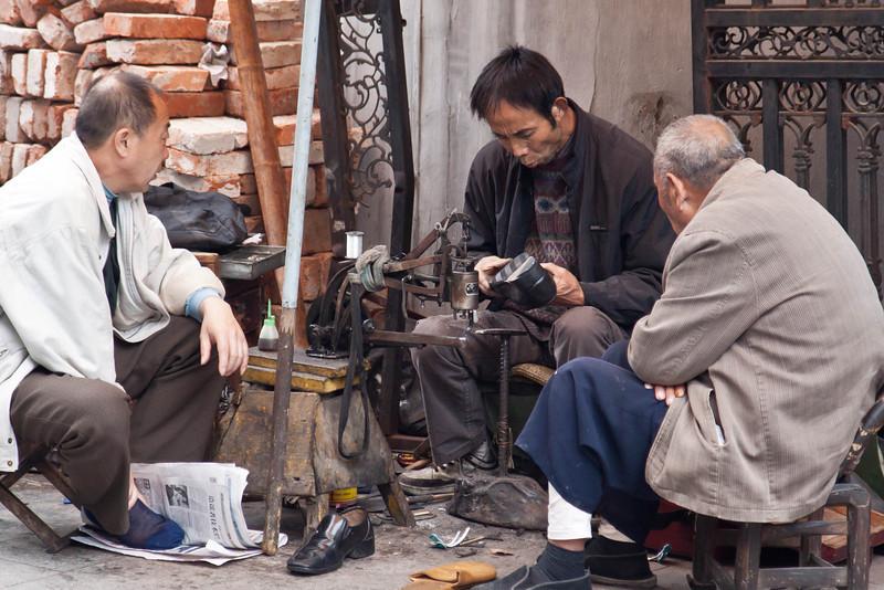 shoe man fixing a shoe.