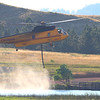 Helicopter coming in to refill with water at Cox Lake to go dump on the Crow Peak Fire near Spearfish