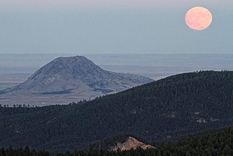 Supermoon rising near Bear Butte