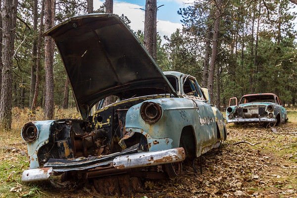 Old cars at the ghost town of Spokane