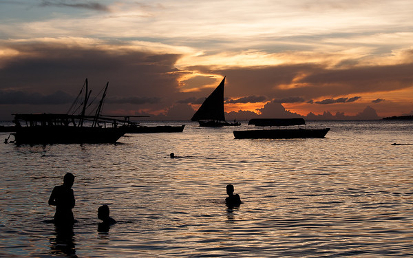 Stone Town's younger inhabitants enjoy jumping from the city's seawall to cool off in the Indian ocean at dusk.  Tanzania, 2013.
