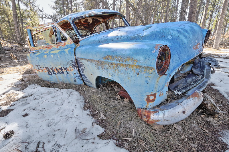 Old car at the ghost town of Spokane