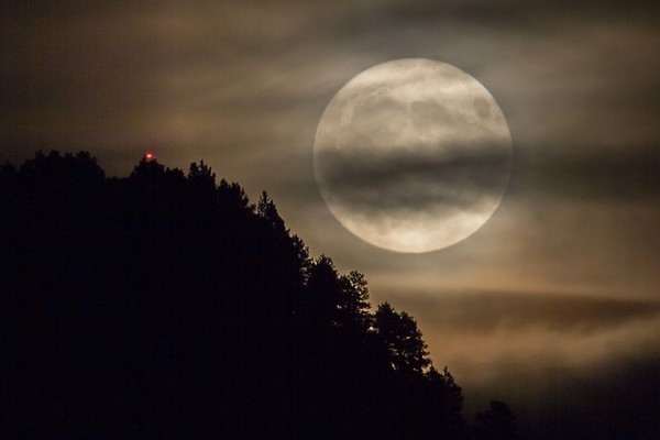 Full harvest moon over Lookout Mountain in Spearfish