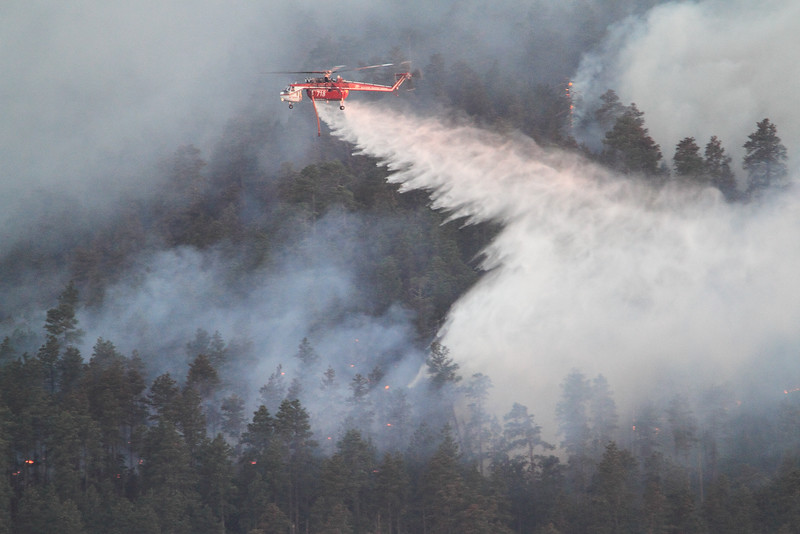 Helicopter dumping water on the Crow Peak Fire near Spearfish