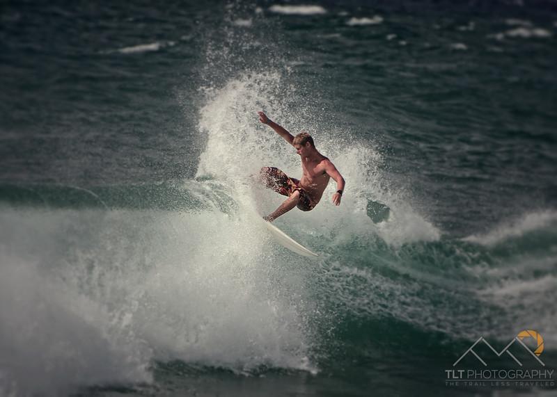Surfer at Poipu, Kauai