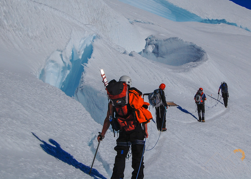 Our group passing by a huge crevasse field on our way down from the summit of Mount Rainier, Washington. Chris Holm and I are in the lead. Please Follow Me! https://tlt-photography.smugmug.com/