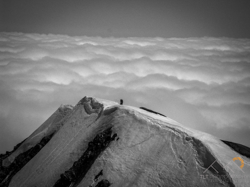 Looking back at Ben Nielsen and Mike in the distance where we reached the rim of Mount Saint Helens above a sea of clouds. Please Follow Me! https://tlt-photography.smugmug.com/