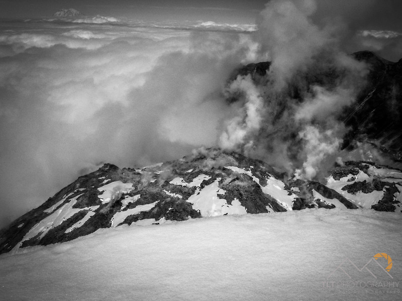 Looking from the crater rim of Mount Saint Helens across the growing lava dome in the center towards Mt. Rainier in the distance to the north.  This is when the crater was still actively producing lava. Please Follow Me! https://tlt-photography.smugmug.com/