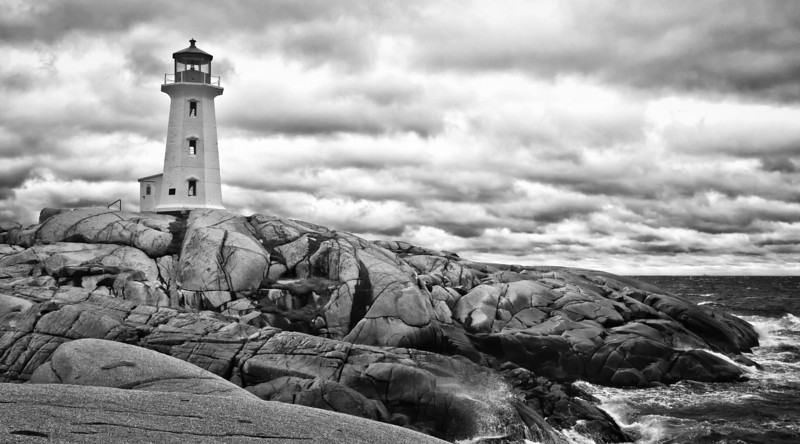 Peggy's Cove Lighthouse<br /> The winds were gusting to 80 mph when we were there.  Makes taking a steady shot difficult even with a tripod.