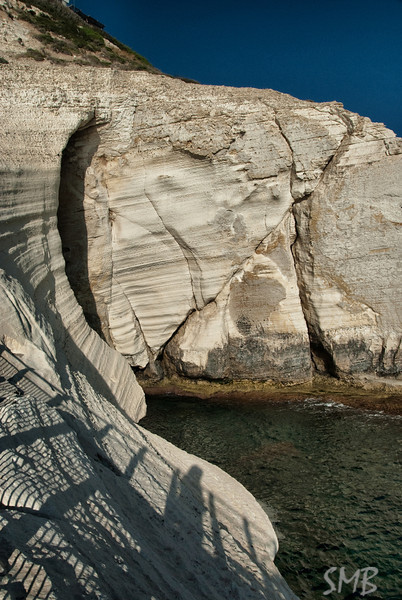 Chalk cliffs and my shadow at Rosh HaNikra grottoes at the northern end of Israel, right on the border with Lebanon.
