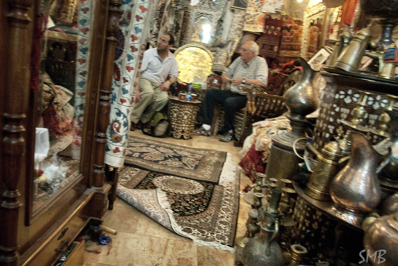 Haggling over rugs in Jospeh's shop<br /> Jerusalem, Israel