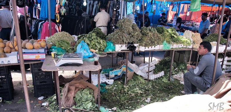 selling green stuff. I didn't identify it all<br /> <br /> Amman, Jordan
