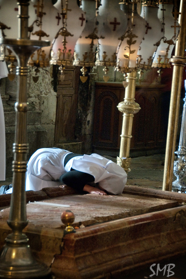 She is a Russian nurse (not a nun), praying. Crazy that it looks like she is all alone. There were people walking in and out everywhere, but since this is natural light it is a long exposure and she did not move.<br /> <br /> The Church of the Holy Sepulchre<br /> <br /> Jerusalem, Israel