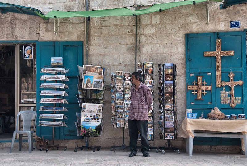 postcards and crucifixes being hawked as Mother Teresa watches...<br /> <br /> Bethlehem, Palestine