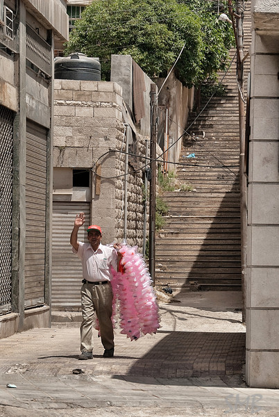 Cotton Candy Man saw us across the street (which was pretty empty) and wanted to sell us pink fluff to help rot our teeth with.<br /> <br /> Amman, Jordan