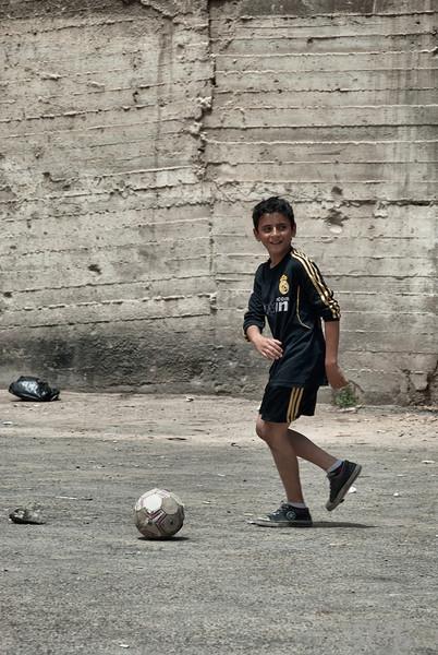 Serious soccer game in an empty lot.<br /> Amman, Jordan