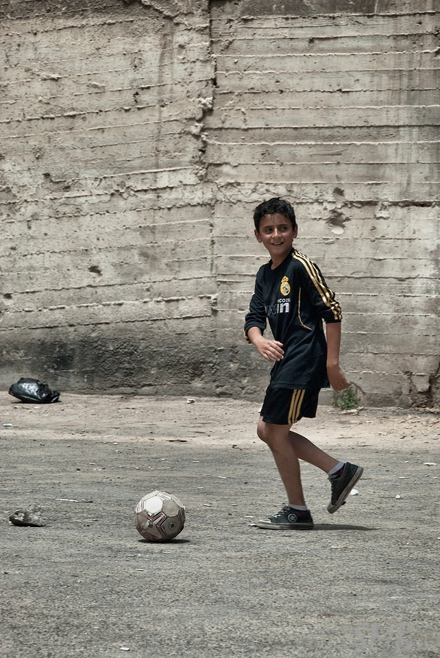 Serious soccer game in an empty lot.<br /> Amman, Jordan