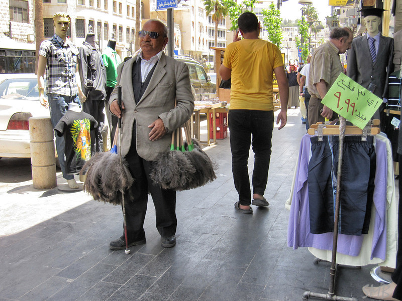 blind man selling feather dusters<br /> <br /> Amman, Jordan