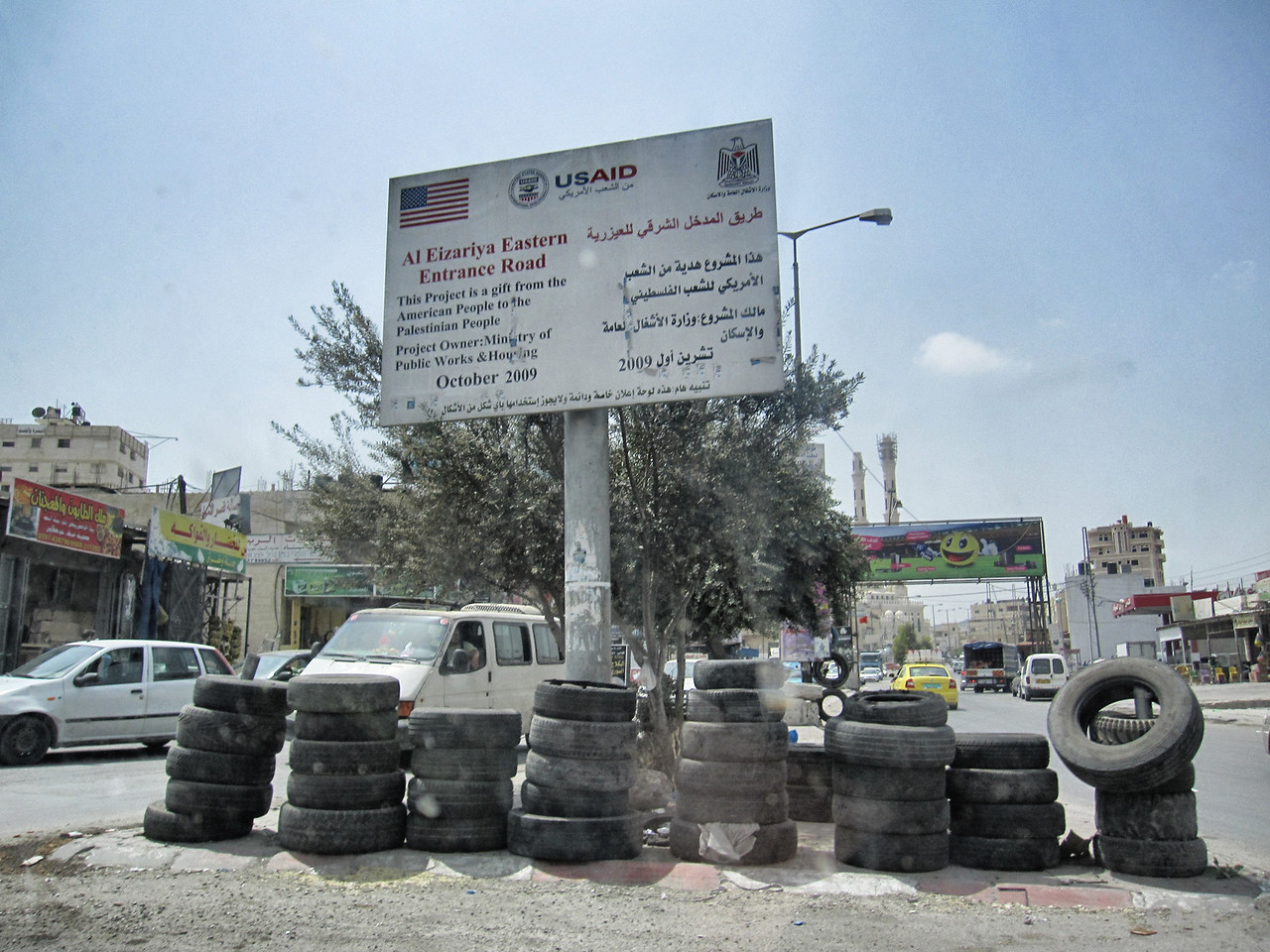 USAID sign, we paid for the entrance road into Ramallah, Palestine