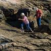 Bobbie and Bob exploring the granite shoteline.