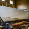 The hull for a 50mph speed boat which will be driven by two 300 hp engines being built at the Hyland shop.