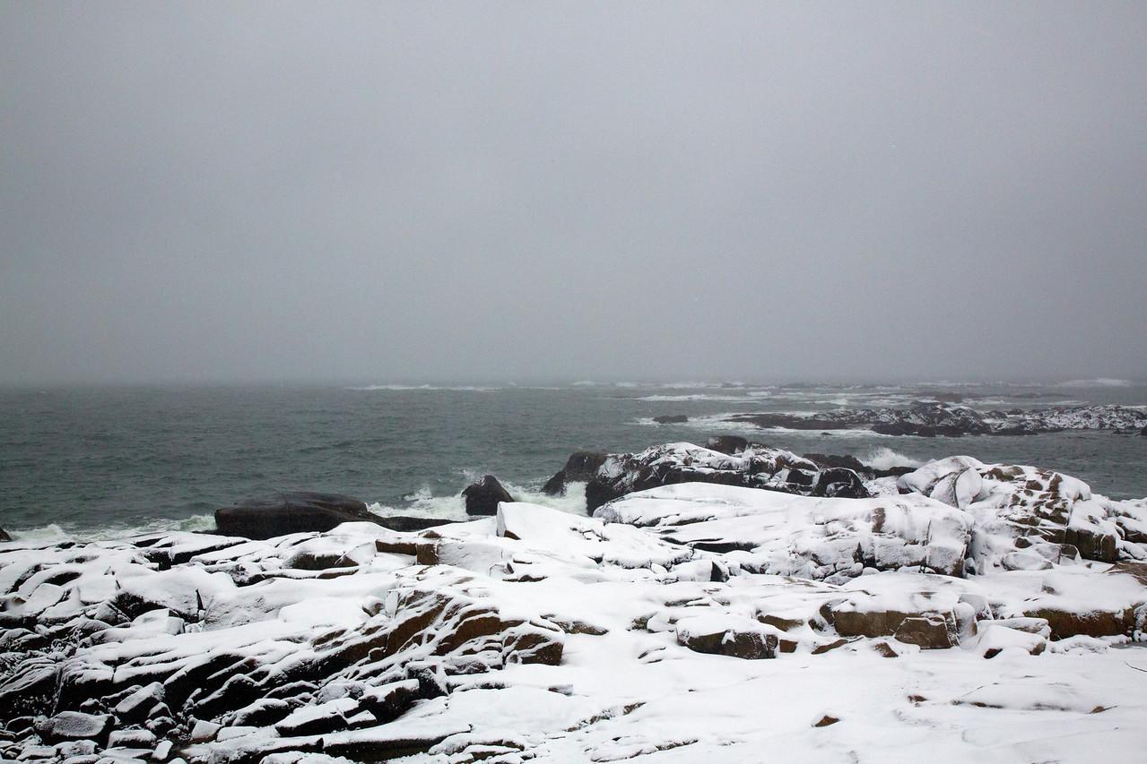 snow rocks ocean C4230