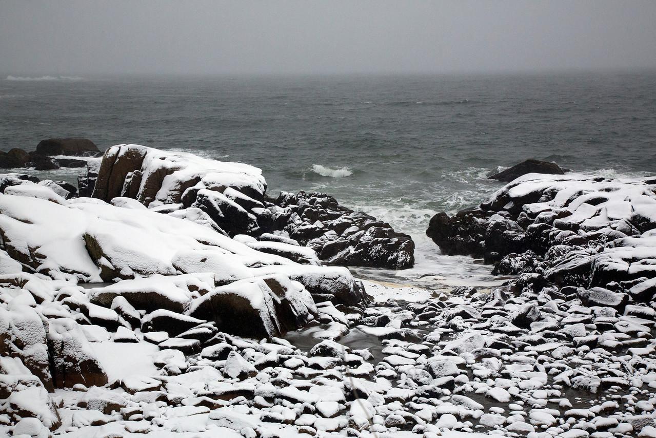 Snow rocks ocean C4228