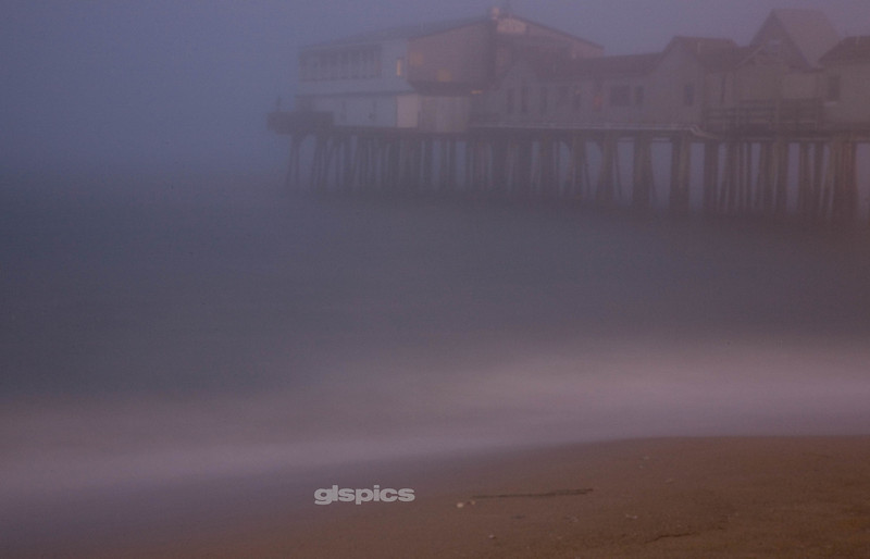 Early morning foggy shot of the pier in Old Orchard Beach, Maine