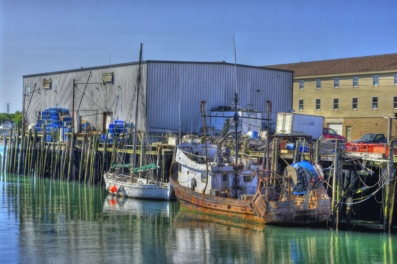 Well used fishing boat tied up at Custom House wharf as seen from A pier Portland Maine.