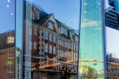Reflection of the Portland Harbor Hotel in the window of Evo across the street